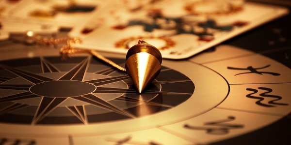 bigstock_magic_pendulum_and_cards_of_ta_16372622
